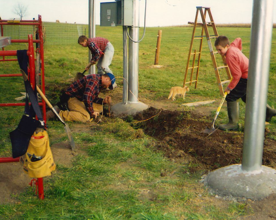 Kids helping with a Solar Project on a Farm